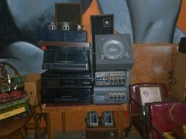Turn Tables, Beta Players, Various Speakers in and out of cabinets, Receivers, Jim Beam Whiskey Train set of Decanters