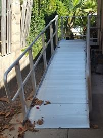 Great Condition Aluminum Ramp and Landing. Fits over the existing 3 step landing.