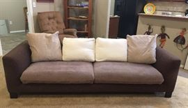 Long, low sofa, deep and comfy with down pillow cushions