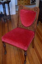 Single vintage chair with velvet seat and back rest.