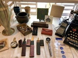 Vintage razors, and a Pewabic Peacock tile.