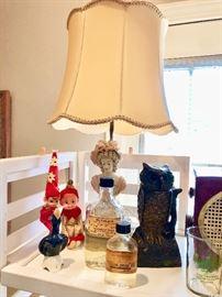 Old kneehugger elves, Detroit Pharmacy bottles, and cast iron owl bank.