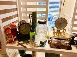 Old Jumbo peanut jar, clocks and eyeglasses.