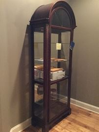 Howard Miller  Beveled Glass  Curio with Dimmer.Glass shelves and lock and mirrored back