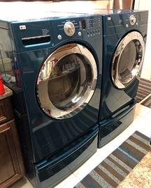 This LG Top Loader Washer & Dryer matching soft blue  with lower storage draws is ideal for the Family, a large-capacity machine handles bulkier items, like bedding and has options for frequent, large loads of clothing and towels.
