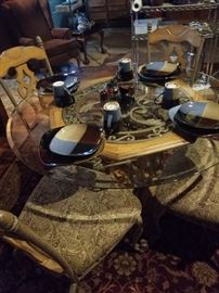 WOOD GLASS AND STEEL  all tastefully combined in a 6 place Dining Set $500 Ashley branded