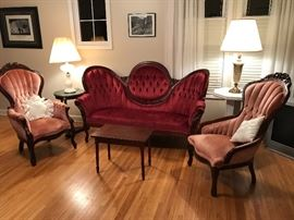 Beautiful 3-Piece Victorian Suite in Excellent Condition and beautiful upholstery.  Owners paid $1,000 for the sofa and $500 each for the side chairs.  Yours today at a significant savings!  Childs hand-made table, two occasional tables, Milk-Glass Grape Pattern Table Lamp, Gilded Rose Table Lamp complete the setting.