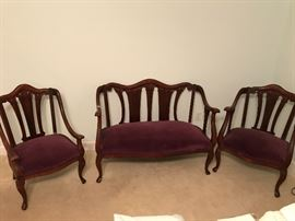 This lovely and delicate French Parlor Set has original finish on aged mahogany wood and a deep plum velvet upholstery.