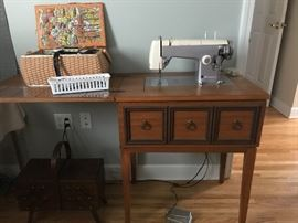 A Sears Brand Electric Sewing Machine in nice Mid-Century cabinet would be a great start for the accomplished seamstress or seamstress wanna-be!  Lots of cool sewing notions also fill this corner of the room.
