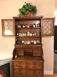 Handsomely crafted this dark oak 1970's Secretary/Bookcase has a roll-top, pull out writing desk and all the storage you need to make this piece a functional part of your home.