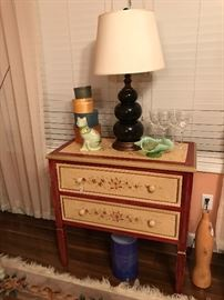 This painted side table/tall chest is just fun!  Well made, sturdy and highly functional.  You're gonna want it!  Crytal stemware, a Fenton Art Glass Bowl, Clever Ceramic Cat, Imitation Shaker Boxes and a Black glass lamp table make this piece welcoming with country hospitality.