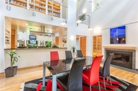 Glass top dining table and leather chairs