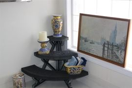 Really nice, plastic shelf from the bathroom with some Asian pottery.