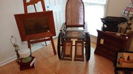 Sturdy, old wheelchair, reminiscent of the FDR era.  Frame, easel, artwork are at least 120 years old, according to our homeowner.