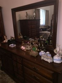 mint condition dressers, night stands, and beds with perfume, small decorative boxes