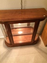 Neat retro curio cabinet located in living room entry