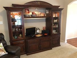 Beautiful Havertys entertainment center media center in this middle it's a 55 inch TV lighted towers and top,  Gorgeous!!