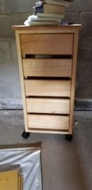 Very nice size storage cabinet with drawers on rollers.