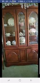 Vintage cherry china cabinet.
