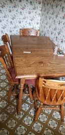 Oak dinette set - table and four chairs.
