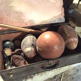 Trunk of vintage sports gear in Mystery Basement!