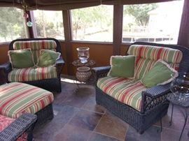 Blue real wicker patio set. Love seat and two armchairs with ottoman. In great condition!