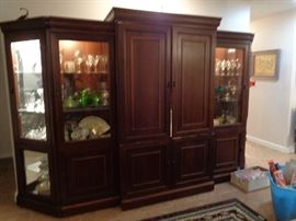 5 piece entertainment center, remove the center piece and have a great china hutch, all areas lighted. pretty nice