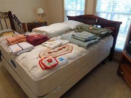 queen bed, assorted linens