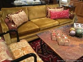Vintage velvet sofa and hammered copper coffee table