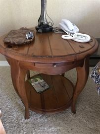 Round wooden oak end table.