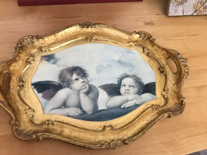 Decorative Cupid themed tray with gold accents.