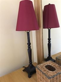 Small boudoir lamp with cranberry red shade.