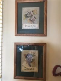 Wine themed prints in wooden frames.