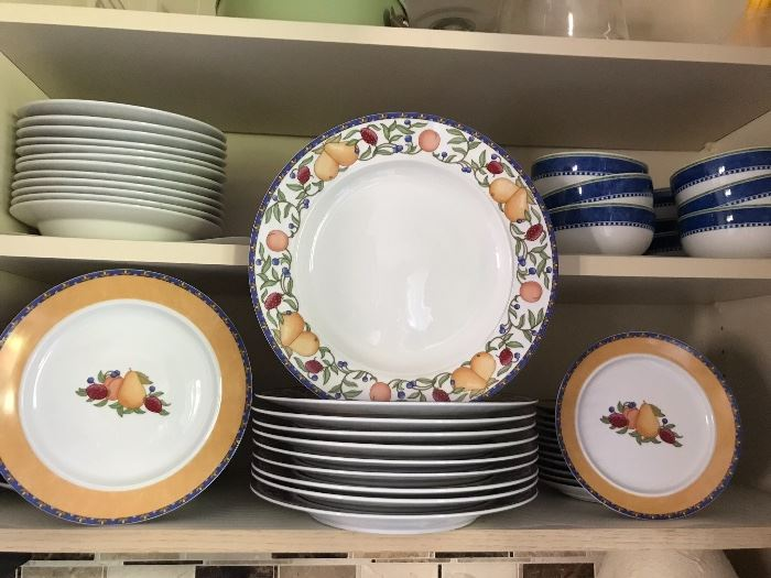 Large set of dishes with fruit motif.