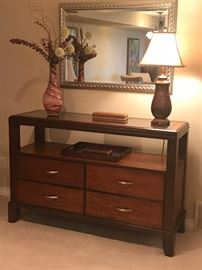 Entrance table with glass top. Beautifully designed storage.
