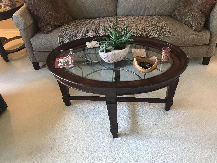 Coffee table with glass top.