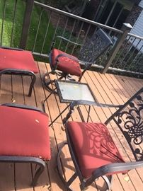 Outdoor patio furniture two chairs with matching ottomans .