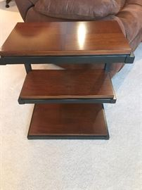 Industrial styled end tables heavy wooden shelves and wrought iron base