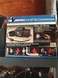 Air America 3/4 HP air compressor in box.