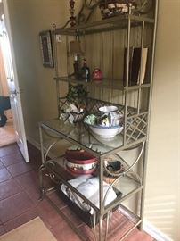 Modern wrought iron stand with glass shelves