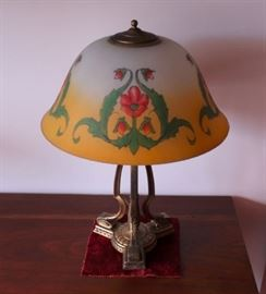 214 - LAMP - Pairpoint, hand painted glass globe in floral and naturalistic motif, cream shaded to yellow, scrolled brass support.