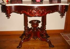 21 - CENTER TABLE - Mid 1800's, rosewood with marble turtle shaped top, base with scrolls, scrolled legs, stylized paw feet on casters.