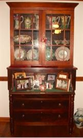 108 - SECRETARY - Circa 1850, burl mahogany, architectural cornice over two mullioned glass doors, mounted on a case with fall front revealing pigeon holes and drawers, over three stacked and graduated drawers flanked by spiral turned columns, ringed and turned feet.