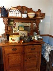 Oak sideboard with vintage kitchen utensils.