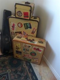 Vintage Luggage with Travel Stamps