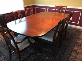 Cherry Dining Table with 6 Chairs (2 Captain), Leaves and Pads.
