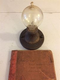 One of the first lightbulbs made. With book