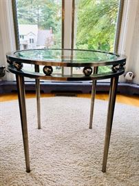 Round, glass top accent table