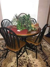 Lovely wood table with four chairs in excellent condition