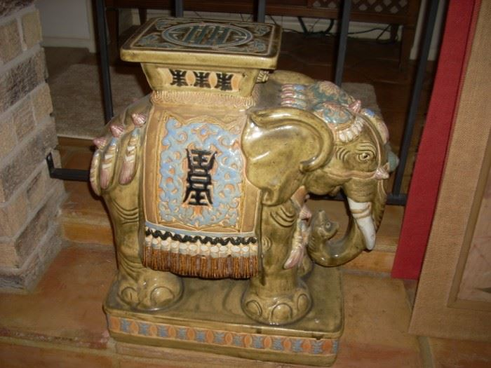 Elephant that serves as a side table, seat, plant stand - but always a conversation piece